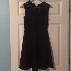 Black dress with beaded collar.